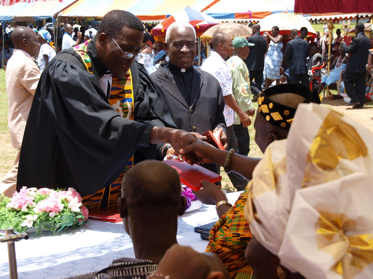 A copy is presented to a chief by Rt. Rev. Dr. Francis Amenu